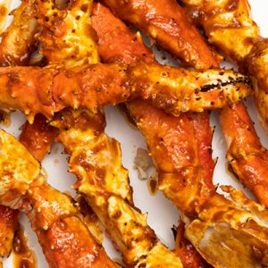 Hawaiian Cajun King Crab Legs with red Hawaiian chili sauce.