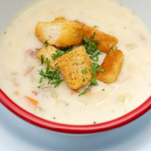 New England style clam chowder topped with croutons.