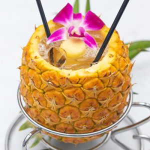 Pineapple Breeze cocktail served in a pineapple.